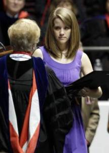 Michelle Downs Whatley accepts the diploma for her sister Danielle Downs who died in the April 27 tornado. (AP photo by Butch Dill)